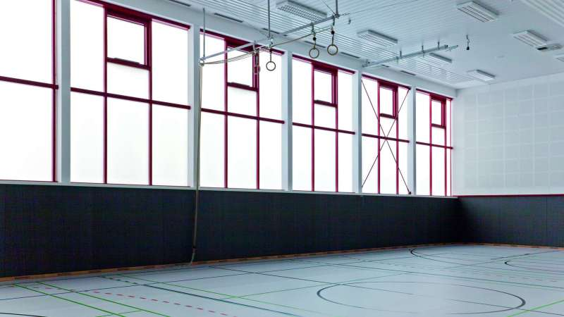 Euregio Gymnasium (School gym) | Bocholt • PLEXIGLAS® Aerogel glazing for the large format single-skin glass facade; U value of 0.77W/m²K and 8 ventilation flaps.