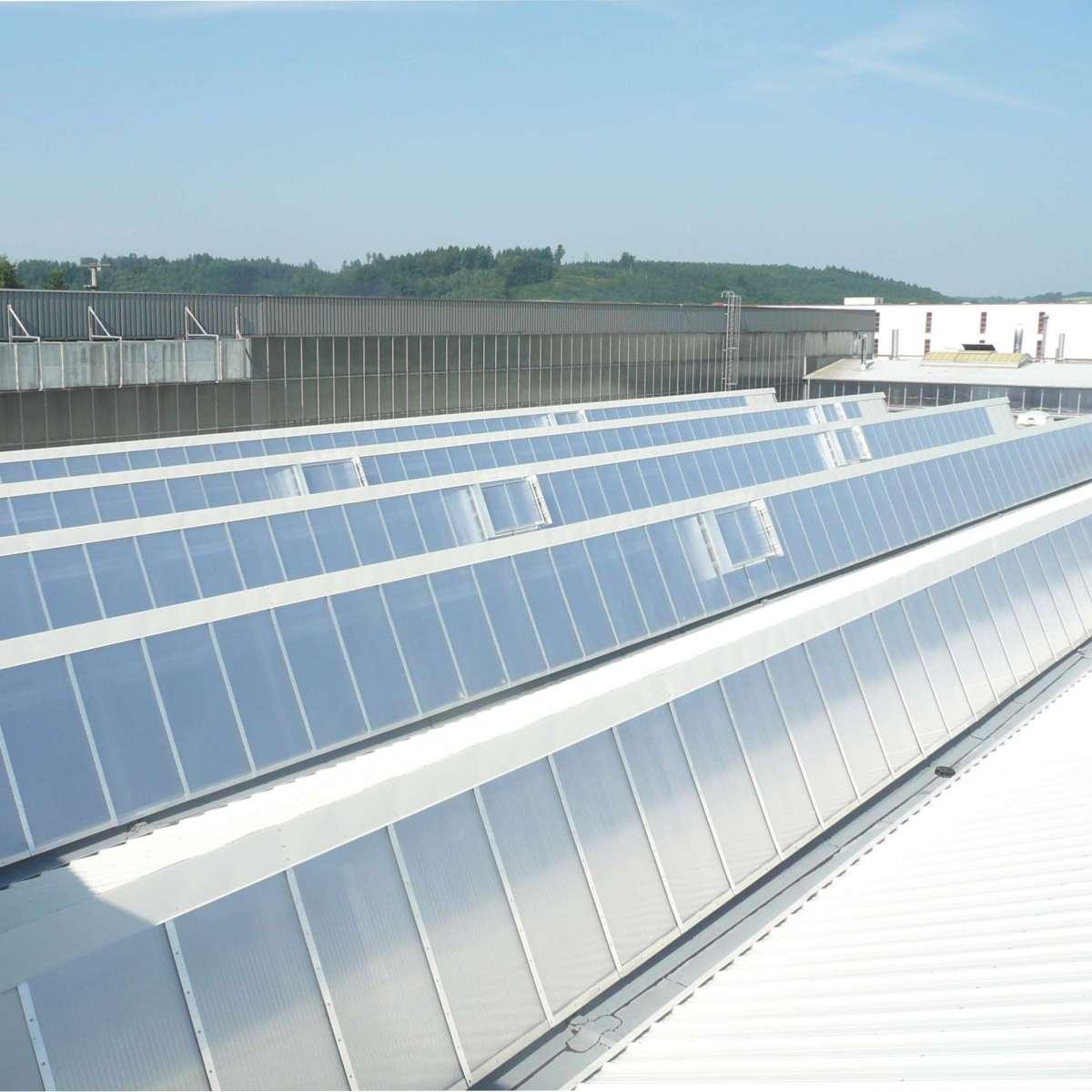 Tegometall Ladenbau GmbH | Krauchenwies • 3000m² shed glazing polycarbonate, 51 NSHEV       louvered ventilators